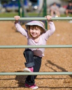 Anastasia climbing on equipment at a park near Bateman's Bay